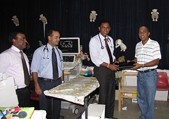 Donation of a laptop computer by Laksaviya foundation Sydney